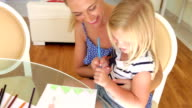 Mother And Daughter Drawing Picture Together video