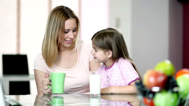 Mother and daughter drinking milk video