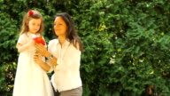 Mother and Daughter enjoy Flowers video