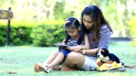 mother and daughter fun with tablet pc video