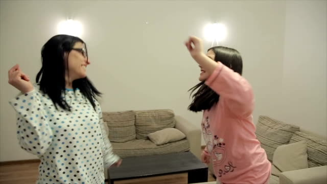 Mother and daughter have pajamas party at home video
