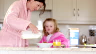 Mother and daughter having breakfast video