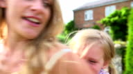 Mother And Daughter Having Fun In Garden video