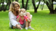Mother and daughter having fun in park video