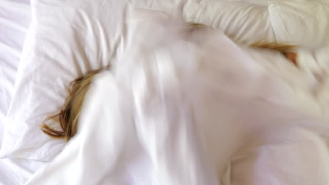 Mother And Daughter Hiding Under Sheet In Bed video