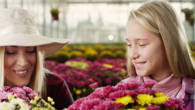 Mother And Daughter In Greenhouse video