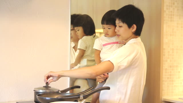 HD : Mother and Daughter in kitchen video