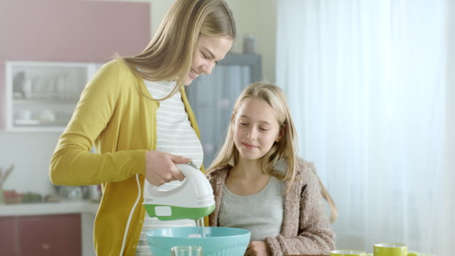Mother and daughter in kitchen video