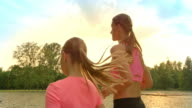 SLO MO TS Mother and daughter jogging in sunshine video