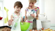 HD: Mother and daughter making cookies. video