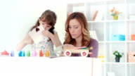HD: Mother and daughter making origami. video