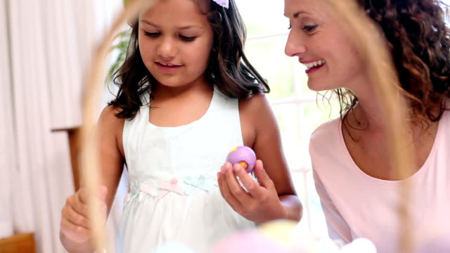 Mother and daughter painting easter eggs video