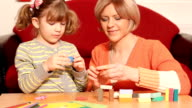 mother and daughter play with plasticine video