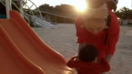 Mother and daughter playing at the park. video