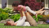 Mother and daughter playing together in yard video
