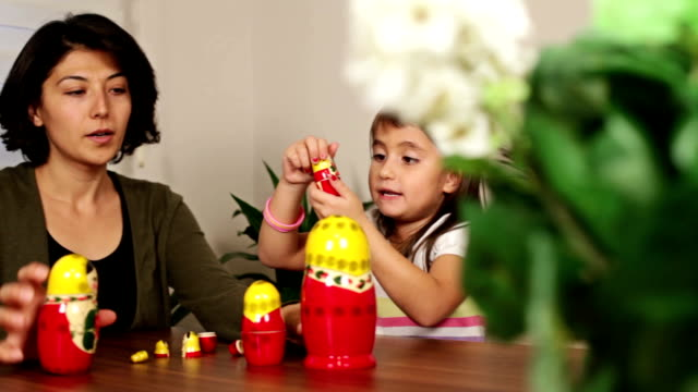 Mother and daughter playing toys video