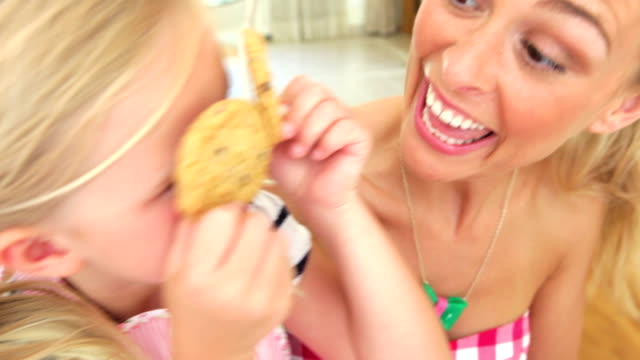 Mother And Daughter Playing With Biscuits video