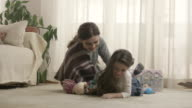 Mother and daughter playing with toys in room. Shot on RED EPIC Cinema Camera in slow motion. video