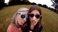 Mother and Daughter  Pose Silly With Sunnies For a selfie video