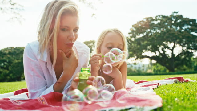 Mother and Daughter Relaxing in Park video