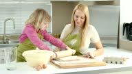 HD DOLLY: Mother And Daughter Rolling The Dough video
