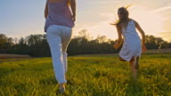 SLO MO Mother And Daughter Running In The Grass video