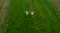 AERIAL Mother And Daughter Running In The Meadow video