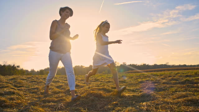 SLO MO Mother And Daughter Running In The Meadow video