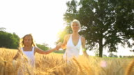 HD SUPER SLOW-MOTION: Mother And Daughter Running In Wheat video