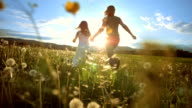 SUPER SLO MO Mother And Daughter Running To The Sun video