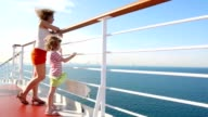 Mother and daughter stands on deck of cruise ship video