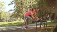 DS mother and daughter stretching on the park bench video