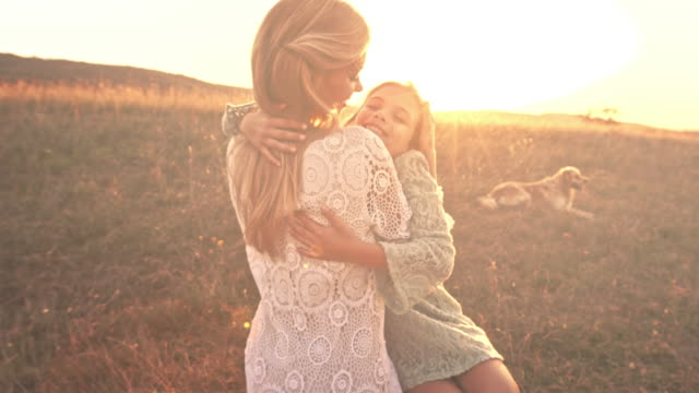Mother and daughter together at sunset video