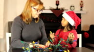 Mother And Daughter Untangling Christmas Lights video