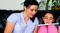 Mother And Daughter Using Digital Tablet video
