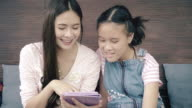 Mother and daughter using tablet video