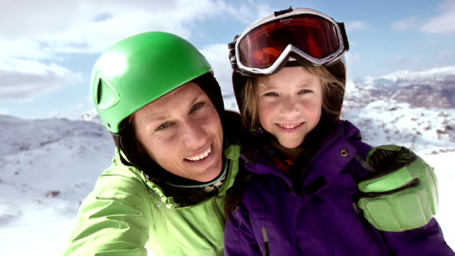 SLO MO Mother and daughter video selfie on ski slope video