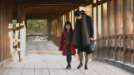 Mother and Daughter walking through Japanese Temple video