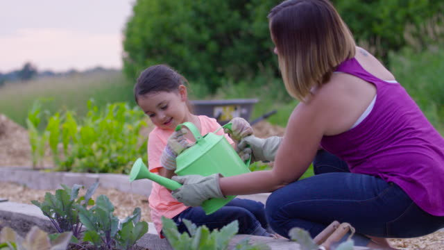 Mother and Daughter Watering Plants video