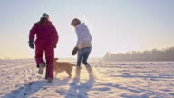 WS Mother And Daughter With A Puppy In Snow video