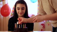 Mother and daughter with birthday cake video