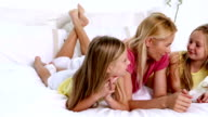 Mother and daughters talking together video