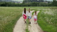 mother and daughters walking holding their hands video