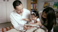 Mother and Father reading with baby video