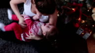 A mother and her baby bonding and having fun video