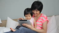 HD : Mother and her baby using Digital Tablet video