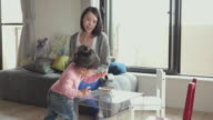 4K, Mother and her children in living room. Tokyo, Japan video