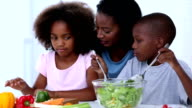 Mother and her children preparing vegetables video
