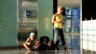 Mother and her little boy waiting at the airport video