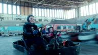 Mother and little daughter rides on karting video